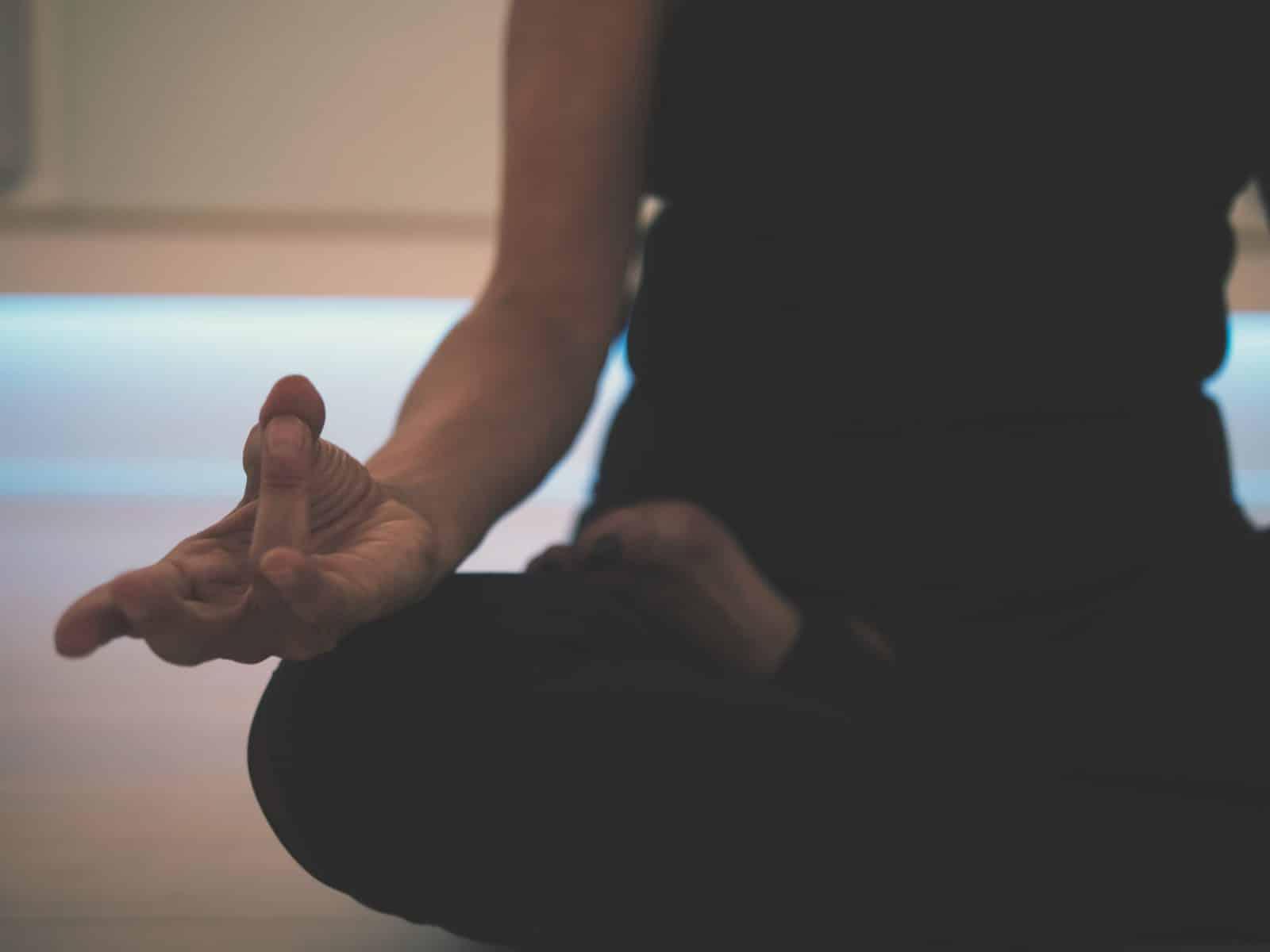 Meditation - person doing yoga on floor